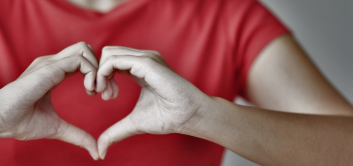 Woman Making Heart Shape with Hands